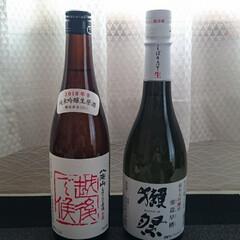 正月/日本酒/あけおめ/おうち/年末年始 お正月のお酒は、獺祭と八海山のどちらも原…(1枚目)