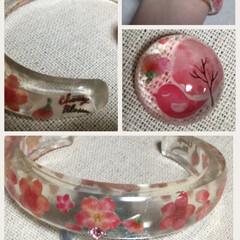 バングル/桜/雑貨/100均/セリア/ダイソー/... 桜満開ですね。  桜のバングルと、指輪用…