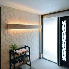 LIXIL/リクシル/エコカラット/室内タイル/タイル張り/内装リフォーム/... ♪玄関スペースの施工事例♪ 玄関の壁一面…