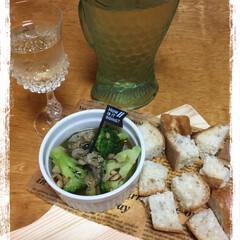 フード 食前酒🥂 牡蠣のオリーブオイル煮🍴(1枚目)