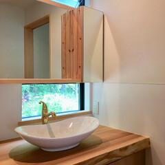 自然素材の家/洗面所/洗面化粧室/洗面コーナー/洗面化粧台/造作洗面化粧台/... 土間に薪ストーブがある自然素材の家の造作…