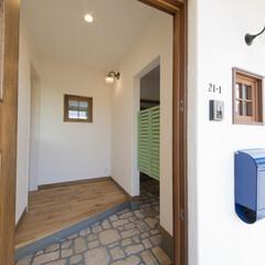 レンガ/ウエスタン/玄関ドア/オーダードア オーダーの玄関ドアとアンティークレンガの…