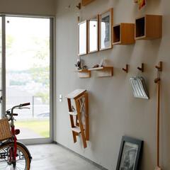 土間/勝手口/掃除用具/DIYグッズ/自転車/おしゃれな家/... . ~勝手口に繋がる土間には  掃除用具…