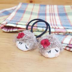 かぎ針編み/ハンドメイド/ヘアゴム/くるみボタン/手作りアクセ  くるみボタンの女の子♪ かぎ針編みのお…